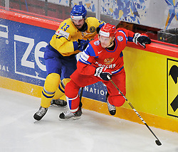 11.05.2012, Ericsson Globe, Stockholm, SWE, IIHF, Eishockey WM, Russland (RUS) vs Schweden (SWE), im Bild, Sverige Sweden 23 Niklas Persson (CSKA Moscow) Russia 6 Denis Denisov (SKA St Petersburg) takle // during the IIHF Icehockey World Championship Game between Russia (RUS) and Sweden (SWE) at the Ericsson Globe, Stockholm, Sweden on 2012/05/11. EXPA Pictures © 2012, PhotoCredit: EXPA/ PicAgency Skycam/ Simone Syversson..***** ATTENTION - OUT OF SWE *****