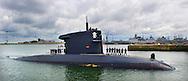 DEN HELDER - De onderzeeboot Hr.Ms. Dolfijn komt aan in de haven van Den Helder na een verblijf van drie maanden in het Somalisch bassin. Het schip heeft geholpen bij het voorkoming van een kaping en het arresteren van Somalische piraten. ANP ROBIN UTRECHT