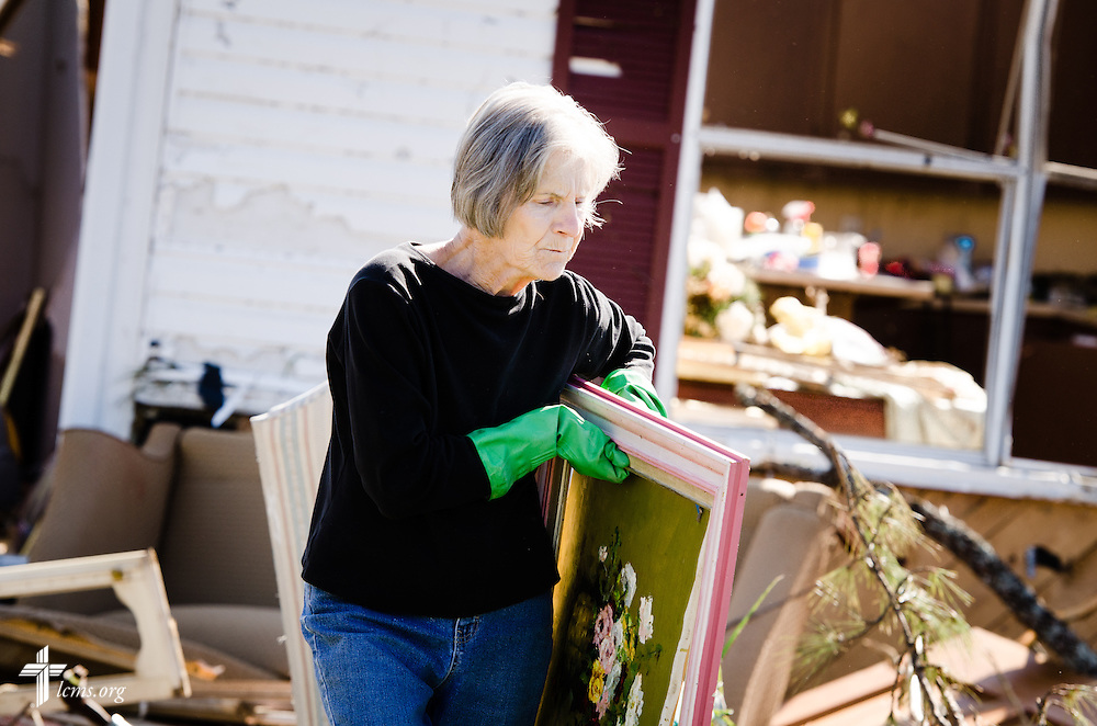 Sudie Clark carries out Connie Lambert's possessions on Friday, May 2, 2014, in Tupelo, Miss., after a tornado ravaged the community earlier in the week. LCMS Communications/Erik M. Lunsford