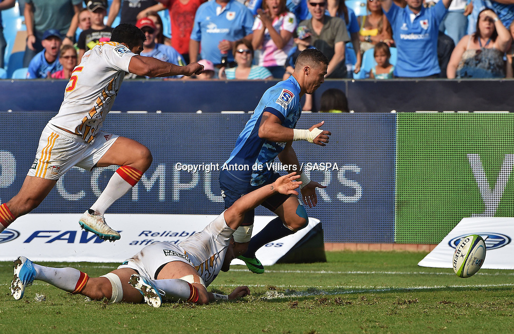PRETORIA, South Africa, 29 MARCH 2014 : Bjorn Basson of the Bulls picks up a loose ball from Liam Messam of the Chiefs for his try during the Vodacom Super Rugby match between the VODACOM BULLS and the CHIEFS at Loftus Versfeld in Pretoria, South Africa on 29 MARCH 2014. The game ended in a 34 all draw.<br /> <br /> &copy; Anton de Villiers / SASPA