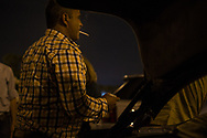 Rafaat enjoys a chat in the parking lot of Beirut's Rafic Hariri International Airport on Tuesday, June 10, 2014.