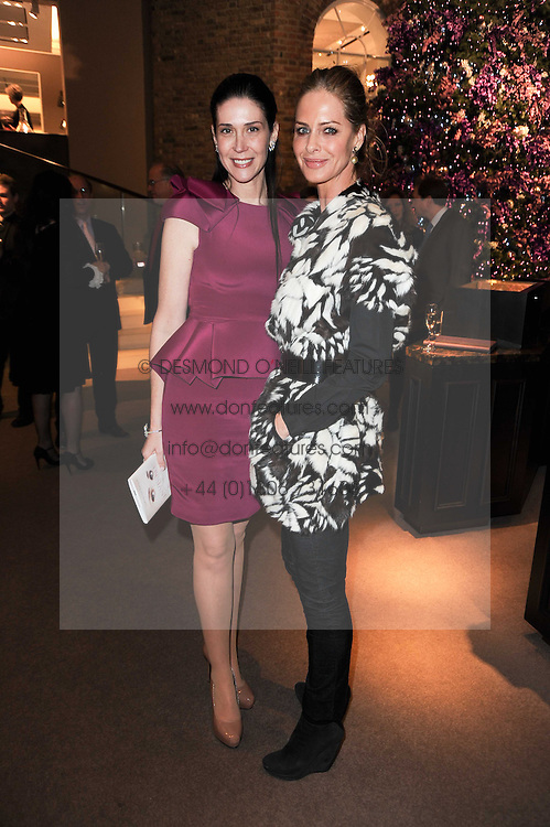 Left to right, COUNTESS NATHALIE VON BISMARCK and TRINNY WOODALL at a party to celebrate the publication of Nathalie von Bismarck's book 'Invisible' held at Asprey, 167 New Bond Street, London on 9th December 2010.