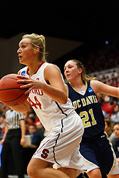 March 19, 2011; Stanford, CA, USA;  Stanford Cardinal forward Joslyn Tinkle (44) dribbles past UC Davis Aggies guard/forward Vicky Deely (21) during the first half of the first round of the 2011 NCAA women's basketball tournament at Maples Pavilion.