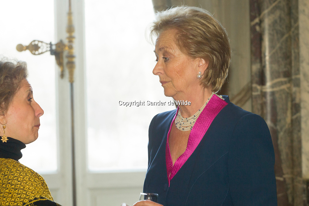 Queen Paola (r) of Belgium talks to Michelle Loewinger during the New Year reception for the Diplomatic Heads of Mission at the Royal Palace on January 11, 2012 in Brussel, Belgium.