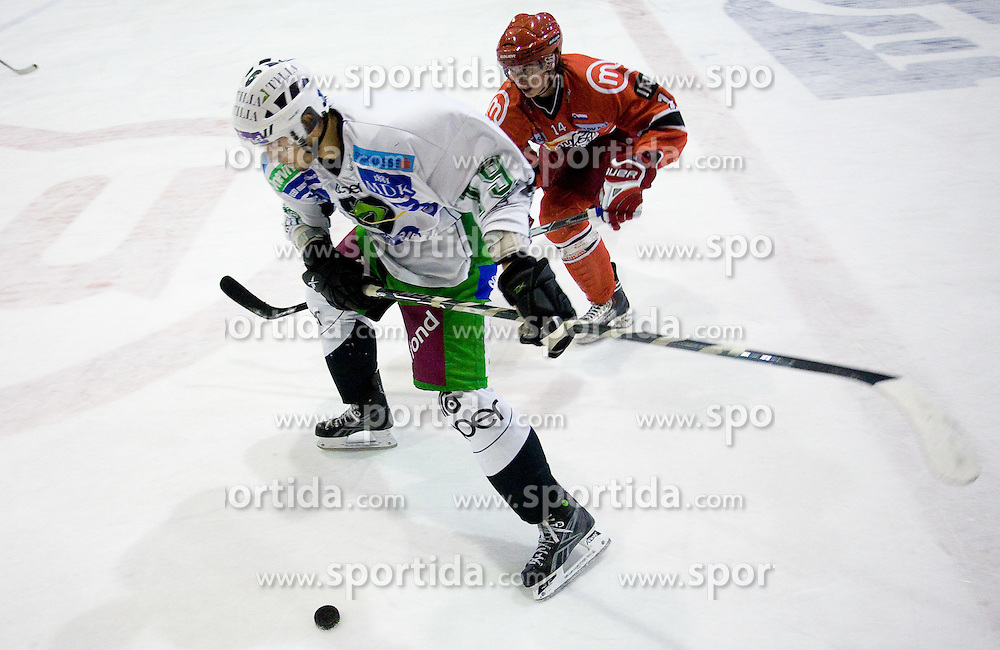 Ziga Pance of Tilia Olimpija and Ziga Jeglic of Acroni Jesenice at 28th Round  ice hockey match of EBEL league between HK Acroni Jesenice and HDD Tilia Olimpija Ljubljana, on December 4, 2009, in Arena Podmezaklja, Jesenice, Slovenia. Olimpija defeated Jesenice 8-7. (Photo by Vid Ponikvar / Sportida)