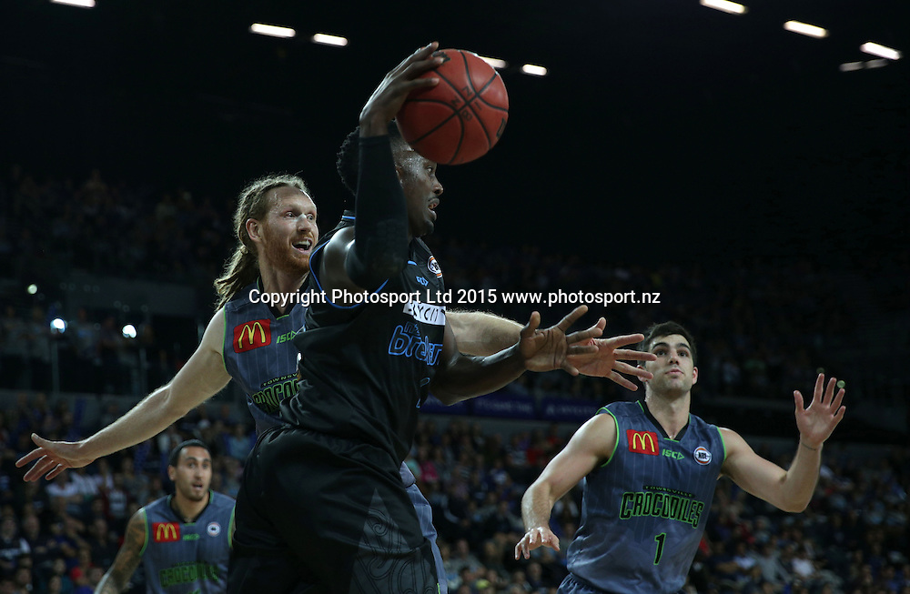 Breakers` Cedric Jackson is challenged by Crocodiles' Luke Schenscher (L) and Corey Maynard in an ANBL Basketball Match, New Zealand Breakers v Townsville Crocodiles, Vector Arena, Auckland, New Zealand, Sunday, October 11, 2015. Copyright photo: David Rowland / www.photosport.nz