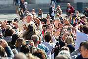 Pope Francis greets the crowd as he arrives for his weekly general audience at St Peter's square on May 16, 2018 in Vatican.