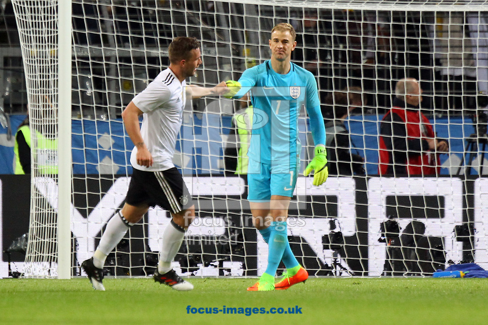 Mutual respect from Joe Hart of England and Lukas Podolski of Germany after he scores his sides 1st goal during the International Friendly match at Signal Iduna Park, Dortmund<br /> Picture by Paul Chesterton/Focus Images Ltd +44 7904 640267<br /> 22/03/2017
