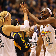 Chiney Ogwumike,  (right), Connecticut Sun, high fives team mate Katie Douglas after their teams first victory of the season during the Connecticut Sun Vs Seattle Storm WNBA regular season game at Mohegan Sun Arena, Uncasville, Connecticut, USA. 23rd May 2014. Photo Tim Clayton