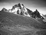 Mount Kenya and giant tree groundsels (Senecio keniodendron) in the Teleki Valley, Mackinder's Camp 4300m (14,100ft), Naro Moru Route.  Batian 5199m (17,057ft), Nelion 5188m (17,021ft) and Point John 4883m (16,020ft) are prominent.  Point Lenana 4985m (16,355ft) is also visible above the Lewis Glacier on the right.  Nikon F4, 28-70/3.5, Kodak E100SW.
