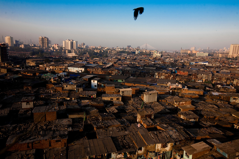 """An ariel view of Dharavi in Mumbai, India, on Feb. 6, 2009.A sprawling slum area in the heart of the fastest growing city in the world, Dharavi and its affiliate slum areas have been thrust into limelight in the year 2008 like never before. Earlier it was the slum redevelopment authorities who threatened to break down the shanties and build new infrastructural projects, and during the far end of the year it was the movie """"Slum Dog Millionaire"""". Winning Gloden Globes, 8 Oscar's & 7 Bafta's the movie has bought to light the ruggedness and the struggle of the life in the slums of Indian cities. While the movie is a fairy tale story of positive endings the real hardship, unemployment and economic disparities seen in the slums is striking and deplorable. Yet the slums of Mumbai offer hope and oppurtunity to the few who travel and live away from their native villages and try make a living out of India's growth curve and rapid industrial progress. .. 2009 brings with it, recession, downturn and unemployment. In this scenario the life in the slum gets more rugged and difficult. This photo essay is a peek into the daily lives of city slum dwellers who live, hope, dream, relax, enjoy in the premises of these slums at the fringes of progress and development awaiting for an oppurtunity to break free into the other side."""