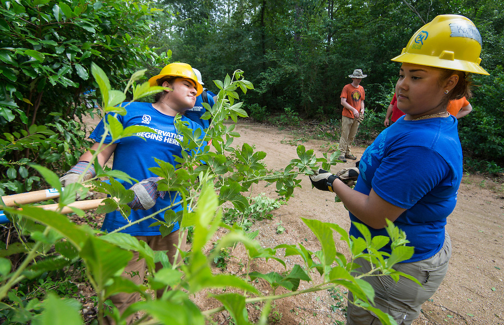 Milby High School senior Karina Sustaita, right, works on a trail at the Houston Arboretum during the Student Conservation Association Houston (SCA) Summer Community Crew Program, July 21, 2014.