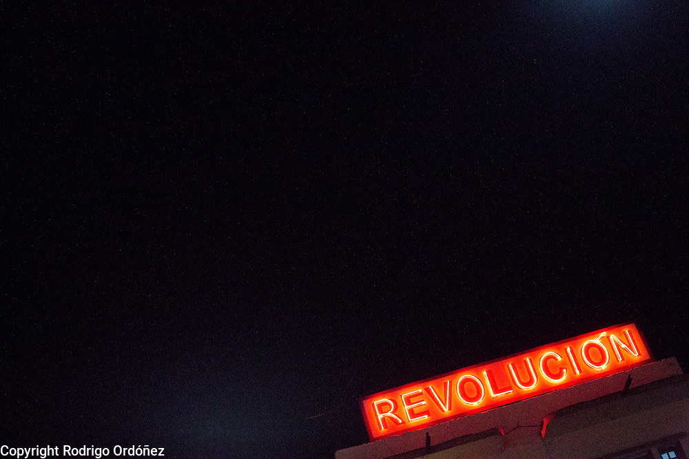 "A neon sign with the word 'Revolución,"" Spanish for revolution stands on top of a building in the streets of Santiago de Cuba, Cuba, on December 25, 2014."