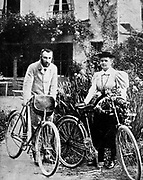 Marie (1867-1934) and Pierre (1859-1906) Curie pictured in their early married life when they enjoyed cycling in the French countryside.