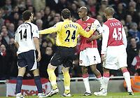 Photo: Olly Greenwood.<br />Arsenal v Tottenham Hotspur. Carling Cup Semi Final 2nd leg 31/01/2007. Arseenal's Abou Diaby and Spurs Hossam Ghaley are kept apart by Manuel Alumunia