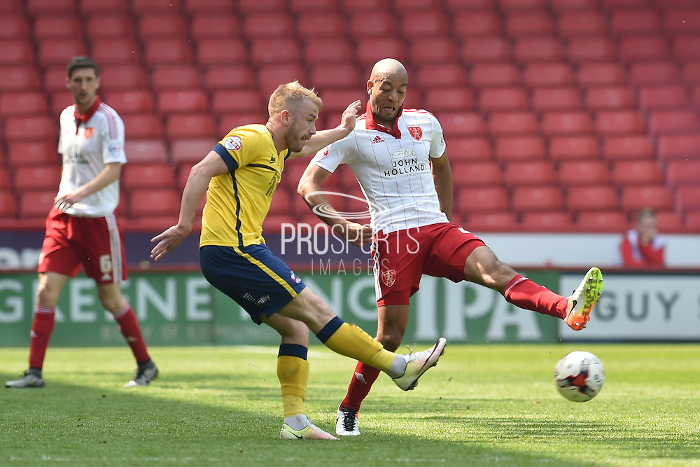 Paddy Madden of Scunthorpe United crosses ball against Alex Baptiste (21) of Sheffield United during the Sky Bet League 1 match between Sheffield Utd and Scunthorpe United at Bramall Lane, Sheffield, England on 8 May 2016. Photo by Ian Lyall.