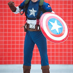 London, UK - 26 May 2013: Eoin Donnelly dressed as Captain America poses for a picture during the London Comic Con 2013 at Excel London. London Comic Con is the UK's largest event dedicated to pop culture attracting thousands of artists, celebrities and fans of comic books, animes and movie memorabilia.