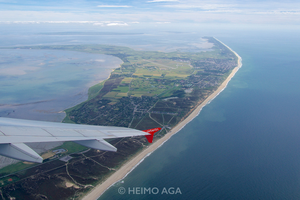 Sylt, Germany. Starting from Westerland Airport aboard an Air Berlin Airbus A320 to D&uuml;sseldorf.<br /> The beach at the Red Cliff at Kampen (foreground m.), Wenningstedt-Braderup and Westerland (middle r.), Hindenburgdamm (middle left), Rantum basin and H&ouml;rnum Odde (the Southern Tip).