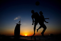 DUBAI, UNITED ARAB EMIRATES - NOVEMBER 21: A footballers practice on the beach in front of the Burg Al Arab hotel during the rest day of the FIFA Beach Soccer World Cup on November 21, 2009 in Dubai, United Arab Emirates.(Photo by Manuel Queimadelos)