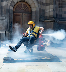 The noughties TV show Brainiac celebrates its Edinburgh Fringe debut with explosives and bangs. <br /> <br /> Pictured: Maggie Frazer with Nitrogen Oxide explosion<br /> <br /> Pictured: Andy Joyce on fire spinning chair