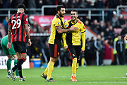 Goal - Roberto Pereyra (37) of Watford celebrates after he scores a goal to give a 0-3 lead with Troy Deeney (9) of Watford during the Premier League match between Bournemouth and Watford at the Vitality Stadium, Bournemouth, England on 12 January 2020.