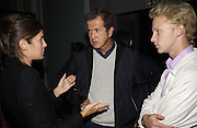 Elizabeth Saltzman, Mario Testino and Jan Olesen. Julian Macdonald fashion show. Science Museum. London. 20 September 2001. © Copyright Photograph by Dafydd Jones 66 Stockwell Park Rd. London SW9 0DA Tel 020 7733 0108 www.dafjones.com