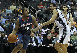 Apr 11; Newark, NJ, USA; Charlotte Bobcats power forward Boris Diaw (32) dribbles the ball past New Jersey Nets center Dan Gadzuric (50) during the second half at the Prudential Center. The Bobcats defeated the Nets 105-103.