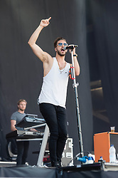© Licensed to London News Pictures. 13/06/2014. Isle of Wight, UK.   Lawson performing live at Isle of Wight Festival .  In this picture - Andy Brown. Lawson is a British pop rock band, consisting of Andy Brown (acoustic guitar and lead vocals), Ryan Fletcher (bass guitar and backing vocals), Joel Peat (lead guitar and backing vocals) and Adam Pitts (drums). The band is currently based in London. The Isle of Wight festival is an annual music festival that takes place on the Isle of Wight. Photo credit : Richard Isaac/LNP