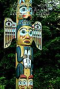 Alaska. Southeast, Ketchikan,  Saxman Native Village Totem Pole Park.  Totem poles, silent storytellers of Tlingit myths and legends. Indian carved totem poles.