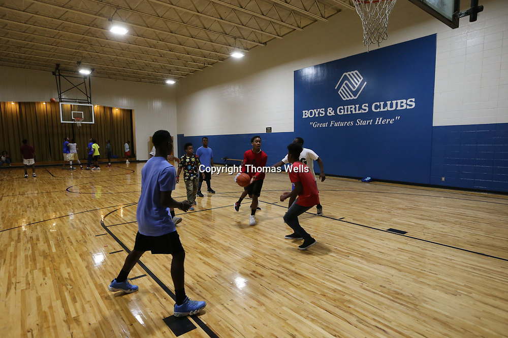 Area youth have a game of basketball at the Northside Boys & Girls Club in Tupelo on Wednesday.