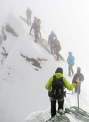 THEMENBILD - Bergsteiger im Nebel am Kleinglockner. Der Großglockner ist mit 3798 m ü.A. der höchste Berg Österreichs und ein beliebtes Ziel zahlreicher Bergsteiger. Er ist in der Glocknergruppe in den Hohen Tauern. Aufgenommen am 11.10.2014 in Tirol, Österreich // Mountaineers in the fog on Kleinglockner. Grossglockner is the highest mountain of austria and is located in the Hohe Tauern mountain range which is part of the central eastern alps. Tyrol, Austria on 2014/10/11. EXPA Pictures © 2014, PhotoCredit: EXPA/ Michael Gruber