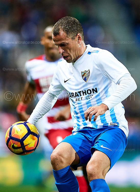 "MALAGA, SPAIN - DECEMBER 09:  Sergio Paulo Barbosa ""Duda"" of Malaga CF in action during La Liga match between Malaga CF and Granada CF at La Rosaleda Stadium December 9, 2016 in Malaga, Spain.  (Photo by Aitor Alcalde Colomer/Getty Images)"
