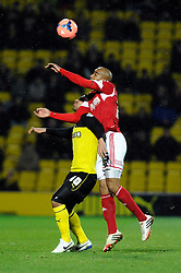Bristol City's Marvin Elliott beats Watford's Lewis McGugan in the air - Photo mandatory by-line: Dougie Allward/JMP - Tel: Mobile: 07966 386802 14/01/2014 - SPORT - FOOTBALL - Vicarage Road - Watford - Watford v Bristol City - FA Cup - Third Round - replay