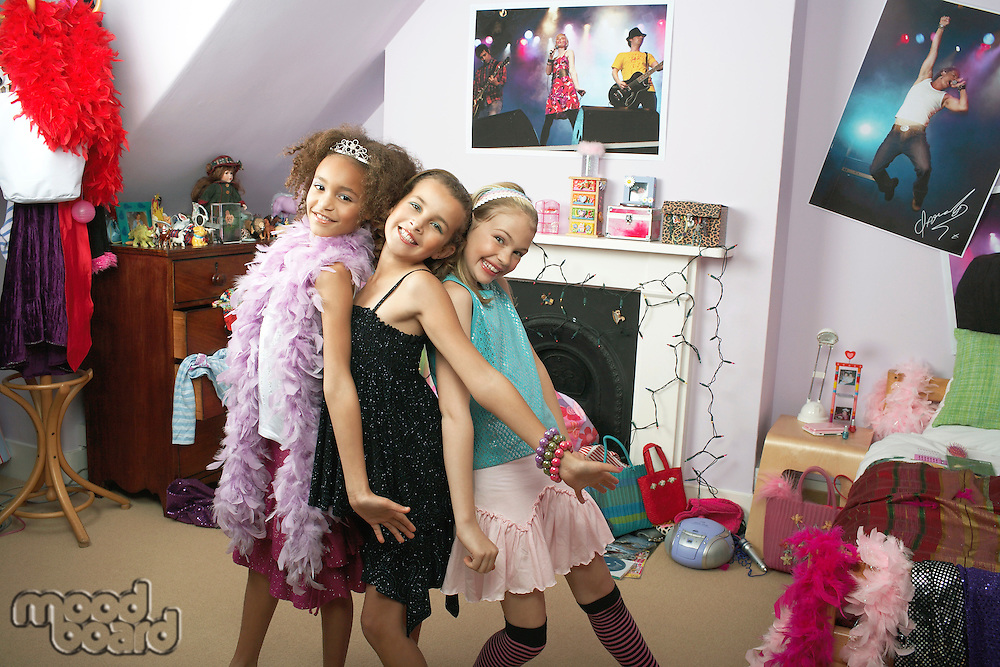 Young Girls striking a pose in trendy bedroom at Slumber Party