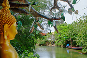 A Buddha statue over looking a stream next to a monastery in Koh phangan, Thailand