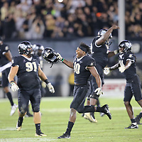 UCF Knights linebacker Titus Davis (10) celebrates with his teammates  during a NCAA football game between the University of South Florida Bulls and the UCF Knights at Spectrum Stadium on Friday, November 24, 2017 in Orlando, Florida. (Alex Menendez via AP)