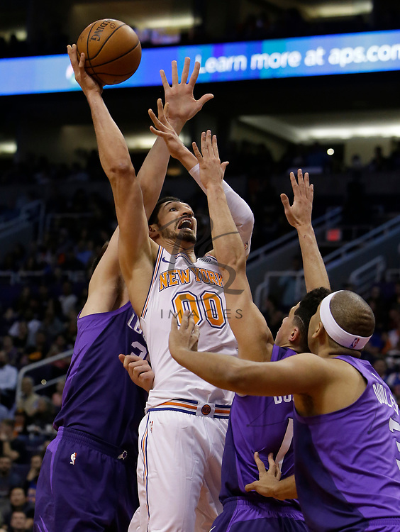 New York Knicks center Enes Kanter (00) in the first half during an NBA basketball game against the Phoenix Suns, Friday, Jan. 26, 2018, in Phoenix. (AP Photo/Rick Scuteri)