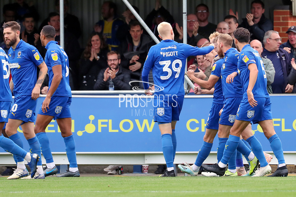 AFC Wimbledon striker Joe Pigott (39) congratulates AFC Wimbledon attacker Marcus Forss (15) on scoring goal during the EFL Sky Bet League 1 match between AFC Wimbledon and Rochdale at the Cherry Red Records Stadium, Kingston, England on 5 October 2019.