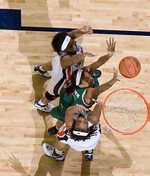 South Florida Bulls forward ChiChi Okpaleke (12) shoots over Virginia Cavaliers Forward Lyndra Littles (1).  The Virginia Cavaliers defeated the South Florida Bulls 73-71 in the third round of the Women's NIT held at John Paul Jones Arena in Charlottesville, VA on March 22, 2007.