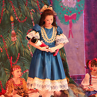 Libby Ezell | BUY AT PHOTOS.DJOURNAL.COM<br /> Clara, played by Hannah Hoang of the Tupelo Ballet, cradles her new Nutcracker doll at Saturday's Matinee performance