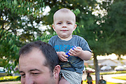 Todd McMahon gives his ten-month-old son, Michael, a ride on his shoulders as Fast Lane Band performs during the Milpitas Summer Concert Series at Murphy Park in Milpitas, California, on July 14, 2015. (Stan Olszewski/SOSKIphoto)