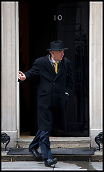 Vince Cable leaves  No10 Downing Street on Budget day, Wednesday March 20, 2013 Photo By Andrew Parsons / i-Images