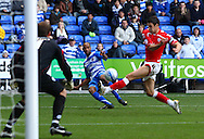 Jimmy Kebe (14) of Reading fires in a cross past Jason Shackell (4) of Barnsley during the Npower Championship match between Reading and Barnsley on Saturday 25th September 2010 at the Madejski Stadium, Reading, UK. (Photo by Andrew Tobin/Focus Images)