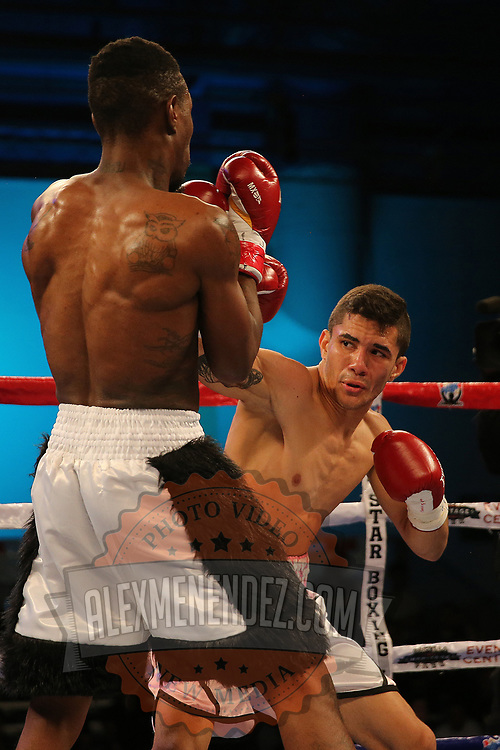 Henry Lebron (R) fights against Ronnie Jordan during a Telemundo boxing match between at Osceola Heritage Park on Friday, February 23, 2018 in Kissimmee, Florida.  (Alex Menendez via AP)