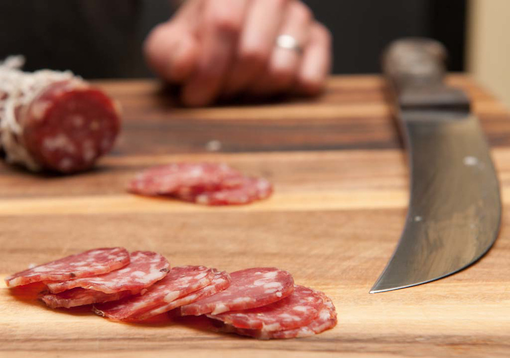 Pine Street Market: The traditional craft of making fresh sausage and cured meats.