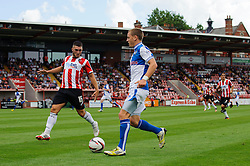 Eliot Richards of Bristol Rovers is challenged by Jordan Moore-Taylor of Exeter City - Photo mandatory by-line: Rogan Thomson/JMP - Tel: Mobile: 07966 386802 03/08/2013 - SPORT - FOOTBALL - St James Park - Exeter -  Exeter City v Bristol Rovers - Sky Bet League 2