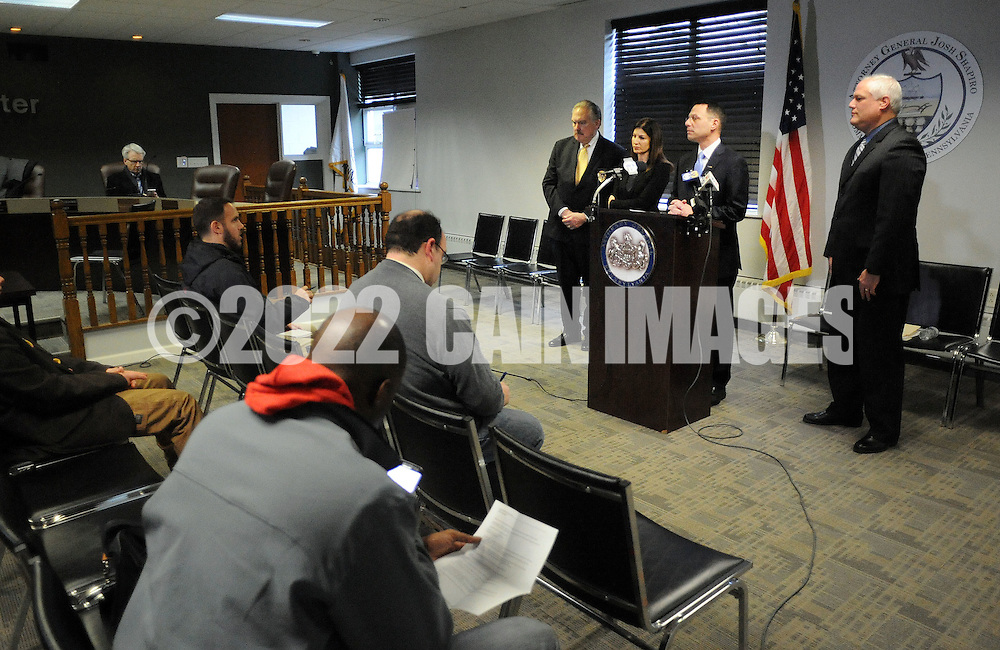 Pennsylvania Attorney General Josh Shapiro (center) and Bucks County District Attorney Matt Weintraub (right) speak with the media after 5 arrests in a child sexual predator ring during a news conference announcing the arrests of Sunday, January 29, 2017 in Warminster, Pennsylvania. (WILLIAM THOMAS CAIN / For The Philadelphia Inquirer)