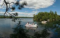 Boaters on Squam Lake, New Hampshire.  ©2013 Karen Bobotas Photographer