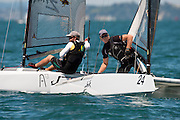 Nathan Outteridge (AUS1004) and Peter Burling NZL275), race nine of the A Class World championships regatta being sailed at Takapuna in Auckland. 16/2/2014