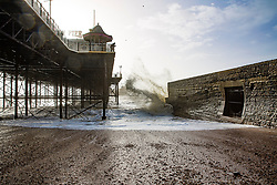 © Licensed to London News Pictures. 30/12/2017. Brighton, UK. Powerful waves crash in to the Pontoon next to the Brighton Palace Pier as strong winds and colder weather is hitting Brighton and Hove. Photo credit: Hugo Michiels/LNP
